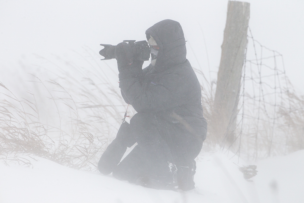 Fred Wasmer photographing in a blizzard