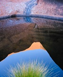 Reflection of rock in pool - Uluru, Australia
