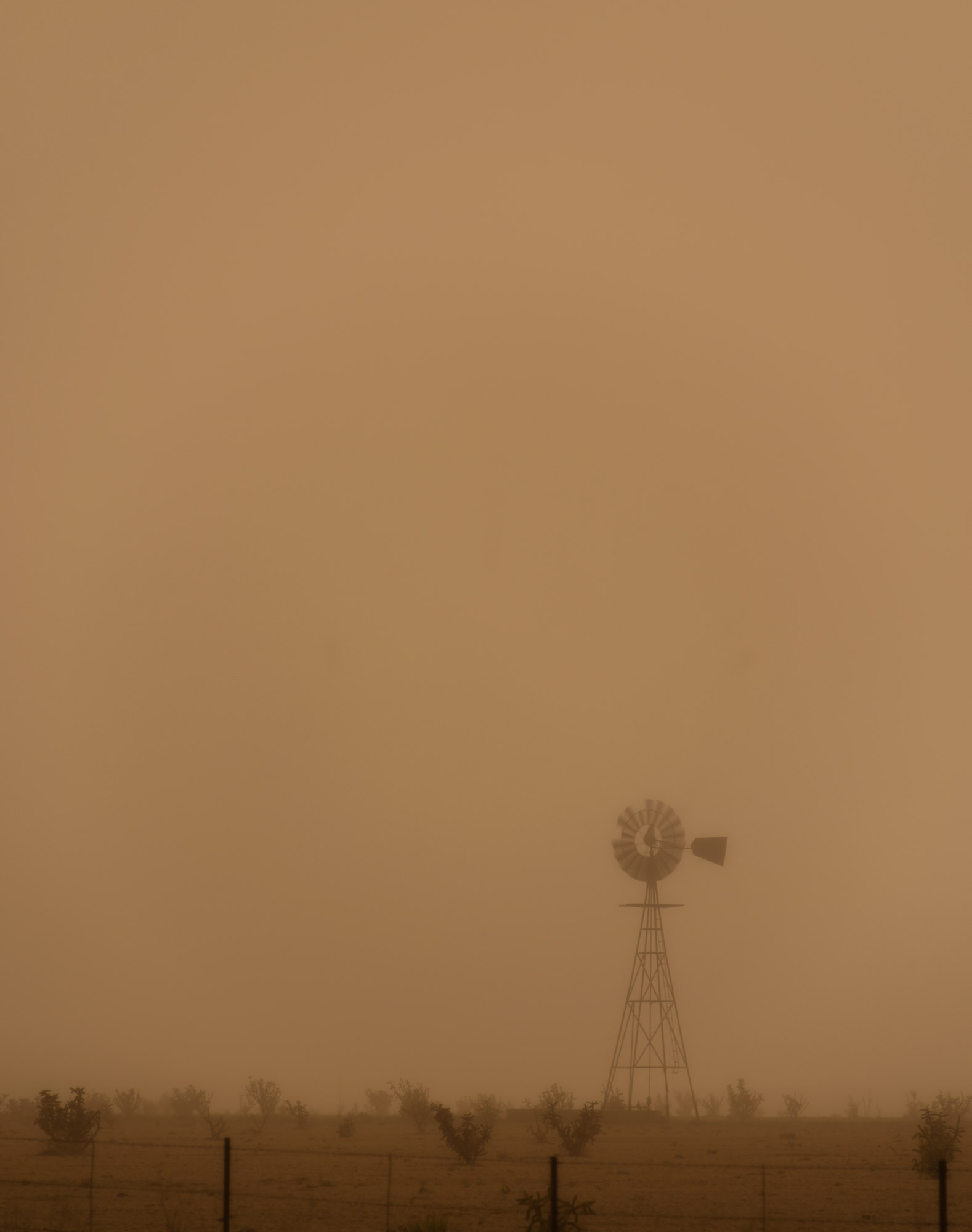 Windmill in dust storm - Grady, New Mexico