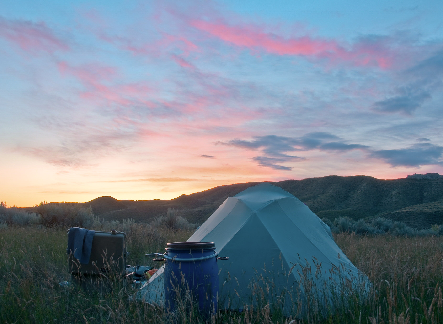 Meadow and tent at sunset, Upper Missouri River Breaks National Monument, Montana