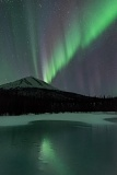Aurora reflected by frozen Dietrich River - Brooks Range, Alaska
