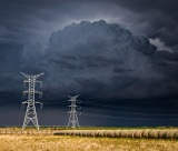Power pylons in front of dark storm - Dickens, Texas