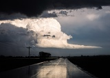 Thunderstorm reflected by wet road - Broadwater, Nebraska