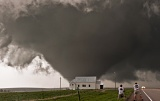Storm chasers photograph tornado passing behind church - near Howes, South Dakota