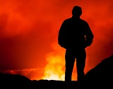 Man looking into Kilauea Volcano - Hawaii Volcanoes National Park