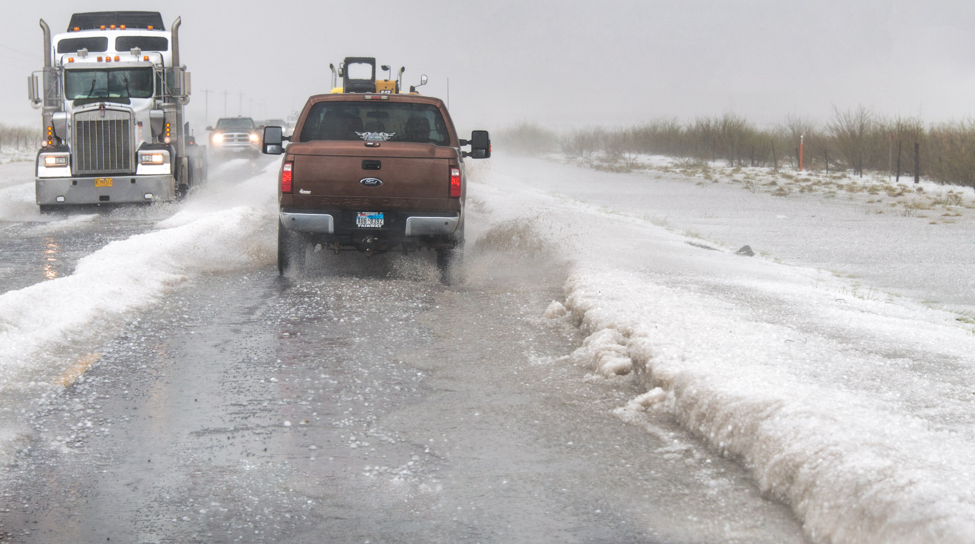 Hail drifts on road - Pecos, Texas
