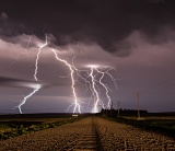 Lightning and farm road - Paxton, Nebraska