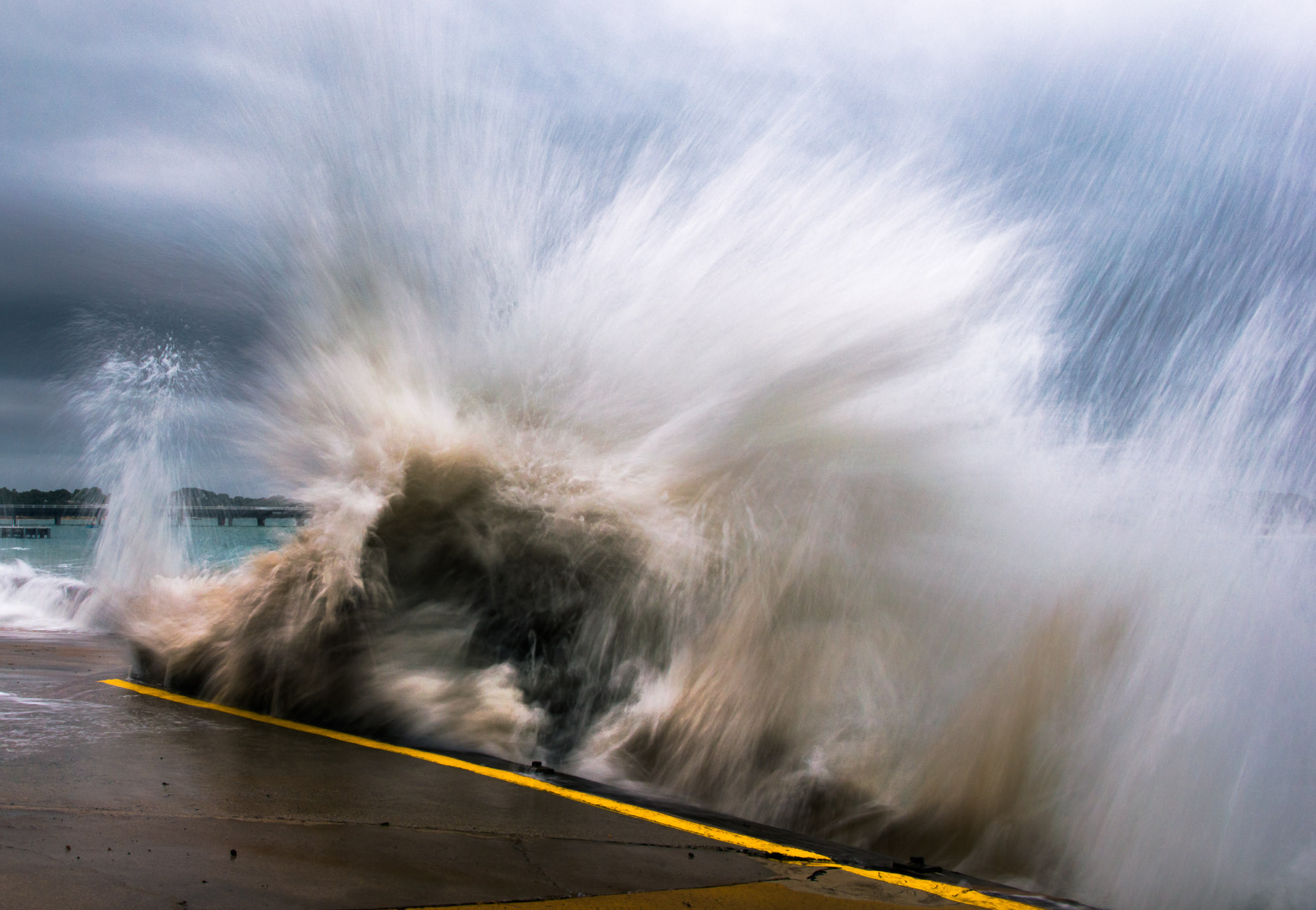 Wave crashing against seawall - Barwon Heads, Victoria, Australia