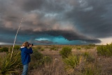 Storm chaser photographing approaching hail storm - Sheffield, Texas
