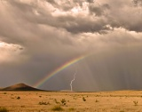 Rainbow, lightning, and anticrepuscular rays - Fort Stockton, Texas