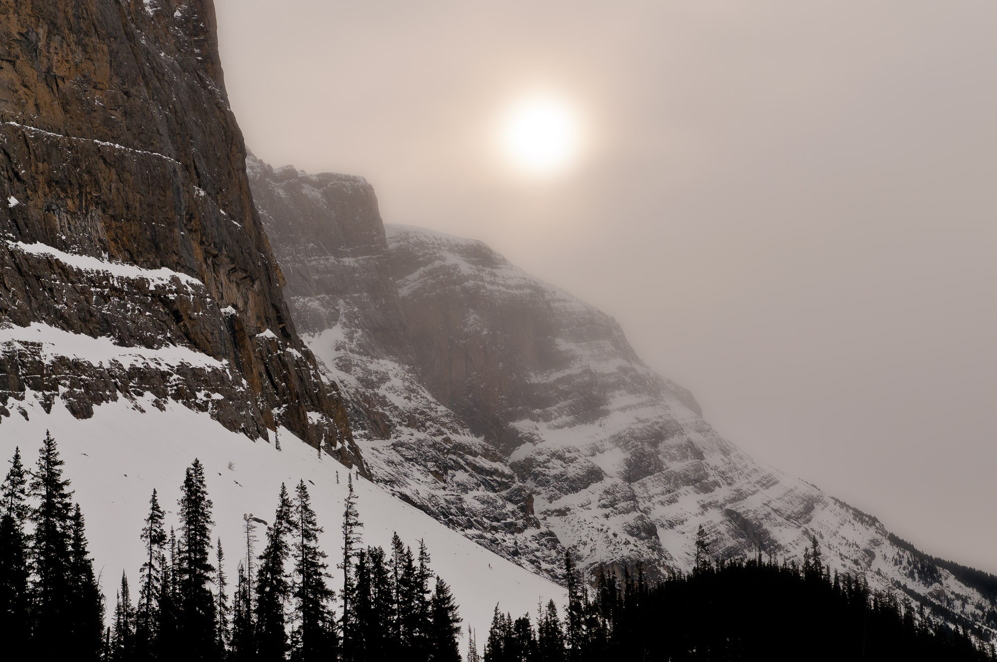 Pale sun and cliffs - Banff National Park, Canada