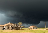 Wall cloud over old farmhouse - east of Plainview, Texas
