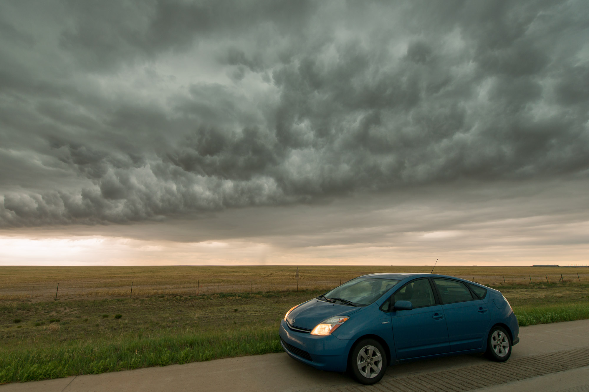 Prius under whale's mouth cloud - Springfield, Colorado