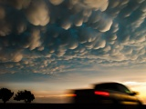 Pickup truck under mammatus clouds - near Woodward, Oklahoma